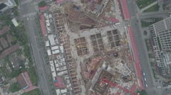 Overhead aerial drone shot flying over a large construction site in Shanghai Stock Footage