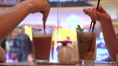 Man and woman having their cold drinks in a cafe against big window. 4K close up Stock Footage