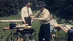 USA 1944: people preparing fish barbecue Stock Footage