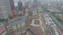 Aerial 'slider' view of a large construction site in Shanghai, China Stock Footage