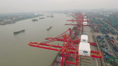 Aerial drone flight over industrial zone cargo container terminal Shanghai China Stock Footage