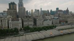Aerial drone shot of historic Bund promenade, historic skyline Shanghai Stock Footage