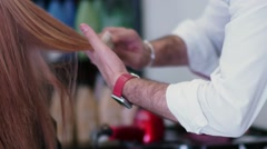 Hairdresser works. Hands male stylist. Comb the hair ends Stock Footage