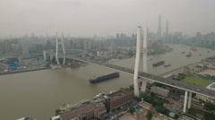Panoramic aerial shot of the massive Nanpu bridge and Huangpu river Shanghai Stock Footage