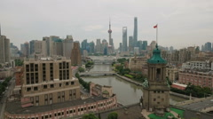 Flying towards the beautiful historic Bund and modern Shanghai skyline Stock Footage
