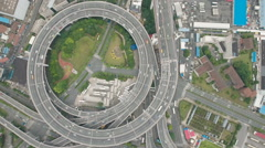 Overhead view traffic driving over elevated round highway in Shanghai, China Stock Footage
