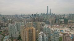Aerial drone flight over beautiful apartment towers to Shanghai skyline Stock Footage