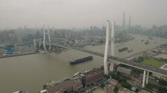 Aerial view of Nanpu bridge and Shanghai skyline Stock Footage