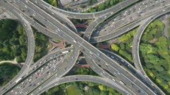 Overhead aerial view modern intersection, traffic infrastructure Shanghai China Stock Footage