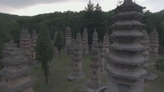 Slow aerial flight over an intimate pagoda forest, cemetery Shaolin temple China Stock Footage