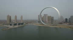 Aerial flight over ghost city, massive ring sculpture in Northern China Stock Footage