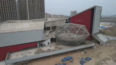 Aerial drone shot of empty opera house, construction site, ghost town China Stock Footage
