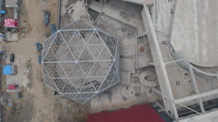 Overhead aerial view construction opera building in 'ghost city' in China Stock Footage