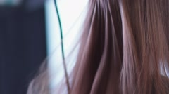 Comb carried by the hair, the hair is dried by hairdryer. Slow-motion Stock Footage