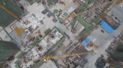 Aerial overhead drone shot of a construction site in China Stock Footage