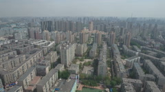 Flying over residential suburban apartment blocks in Shenyang, China Stock Footage