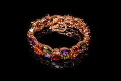 Bracelet with colorful stones isolated on black, close-up Stock Photos