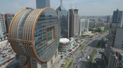 Aerial view massive golden glass building Shenyang, architecture China Stock Footage