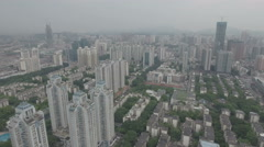 Aerial shot flying over residential apartment buildings in Shenzhen city Stock Footage