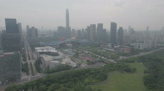 Flying towards the colorful municipal government building and skyline Shenzhen Stock Footage