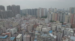 Aerial shot colorful suburban residential apartment buildings in Shenzhen, China Stock Footage
