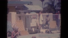 1966: a kid is seen diving in water in a outdoor pool FLORIDA Stock Footage