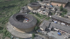 Aerial view of historic round Fujian tulou houses in China Stock Footage