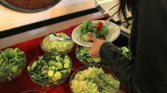 College girls put food on the plate in the students canteen Stock Footage