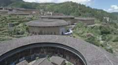 Flying over ancient traditional homes in Fujian province, China Stock Footage