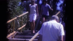 1966: two ladies descending using steps in a park FLORIDA Stock Footage