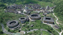 Aerial drone flight over tulou round houses in Fujian province China Stock Footage