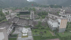 Aerial view collapsed school building at Wenchuan earthquake memorial Stock Footage