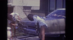 1966: the girls raising cash for the school's number one ranked football team. Stock Footage