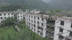 Aerial overview of a heavily damaged school building, Wenchuan earthquake China Stock Footage