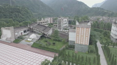 Overview of disastrous collapse of school building, earthquake memorial China Stock Footage