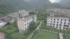 Rising tilting view of a destructed school building, earthquake memorial China Stock Footage
