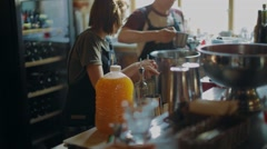 Bartenders prepare drinks at a party Stock Footage