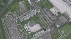 Rotating aerial shot of a partly collapsed school building in China Stock Footage