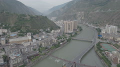 Aerial view of partly rebuilt Weizhou, a town struck by 2008 Wenchuan earthquake Stock Footage