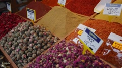 Spices and herbs on a counter of street shop Turkish Bazaar Stock Footage
