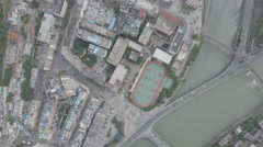 Overhead view of playground and apartment buildings Weizhou, Wenchuan county Stock Footage