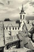Annunciation church and red roofs of old houses, Szentendre, black and white Stock Photos