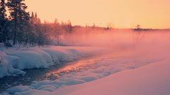 Evening Rose Mist over the Snow-Covered Forest and a River Stock Footage