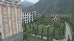 Aerial view of heavily damaged school, Wenchuan earthquake memorial Stock Footage