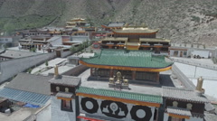 Slow drone shot of Tibetan monastery complex in China Stock Footage