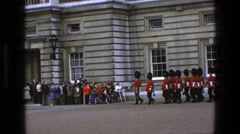 1969: formal marching of the guards is watched by many at windsor castle. Stock Footage