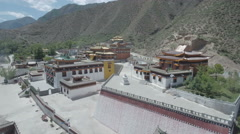 Aerial footage of a classic Tibetan monastery in central China Stock Footage