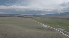 Beautiful aerial shot of widen open grassland pastures in Tibetan region Stock Footage
