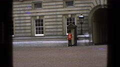 1969: a guard is seen standing alert in front of a royal building ENGLAND Stock Footage