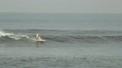 Girl is Riding on the Waves Stock Footage